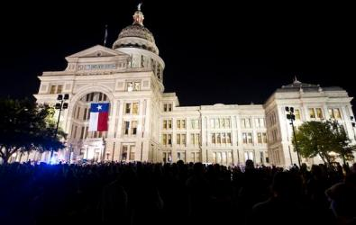 Ricardo B. Brazziell/American-Statesman 12/1/12 Thousands of people gathered at the Texas State Capitol and at 11th and Congress to watch the Lighting of the new Christmas tree on Saturday, Dec. 1 2012.